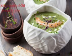 Broccoli, spinach cream soup with shrimp in a white bowls on a wooden board